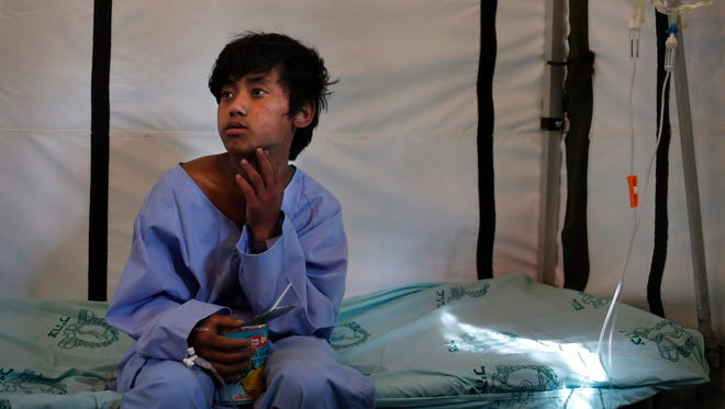 Pemba Tamang, 15, recovers April 30, 2015, at the Israeli field hospital for earthquake victims after being rescued in an operation led by a Nepalese team with American responders from the U.S. Agency for International Development assisting them, in Kathmandu, Nepal.