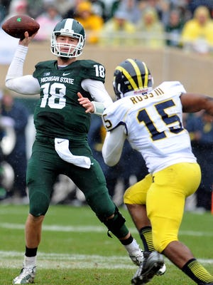 MSU's Connor Cook gets a pass off past Michigan's James Ross III during their game on Nov. 2, 2013 in East Lansing.