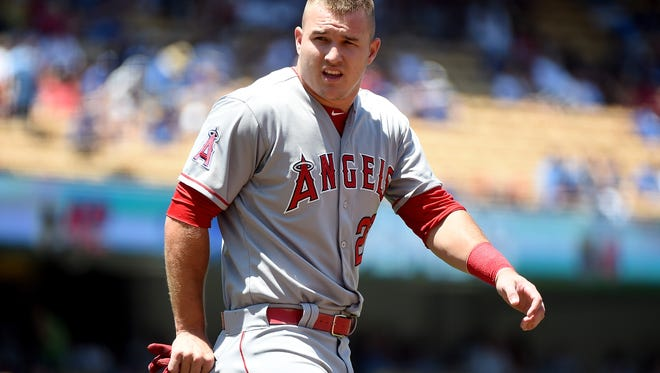LOS ANGELES, CA - AUGUST 01:  Mike Trout #27 of the Los Angeles Angels reacts to his strikeout during the first inning against the Los Angeles Dodgers at Dodger Stadium on August 1, 2015 in Los Angeles, California.  (Photo by Harry How/Getty Images)