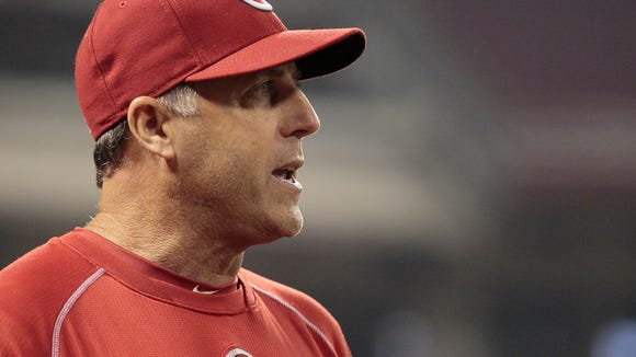 Reds manager Bryan Price during a pitching change against