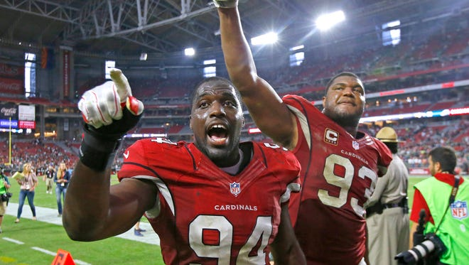 Arizona Cardinals outside linebacker Sam Acho (94) and defensive end Calais Campbell (93) celebrate their 24-20 win over the Philadelphia Eagles. The team is 6-1.