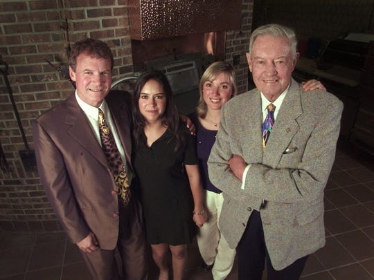 From left, Danny Wegman, his daughters, Nicole and Colleen Wegman, and patriarch Robert Wegman at the Pittsford store in 1997.
