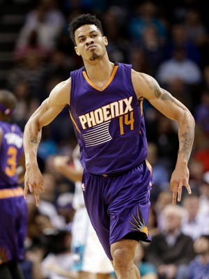 Phoenix Suns' Gerald Green reacts after making a 3-point basket against the Charlotte Hornets during the first half of an NBA basketball game in Charlotte, N.C., Wednesday, Dec. 17, 2014. (AP Photo/Chuck Burton)