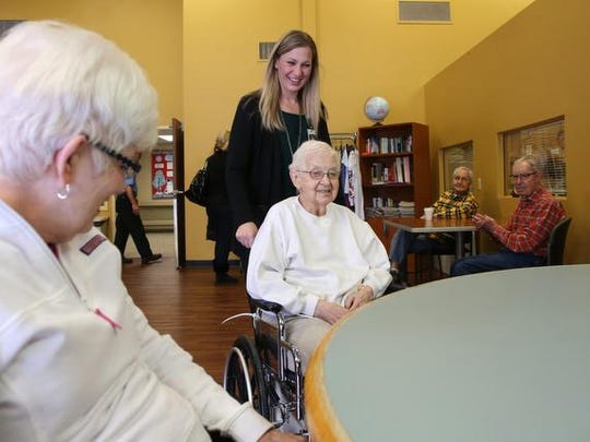 operations director, brings Rosemary Hall into an activity
