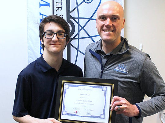 Student Nick Wood, left, is presented the Student of the Month award by STEM Academy Principal Rob Sherburne.