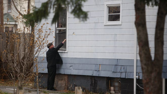 Rochester police investigate a homicide at 26 Ludwig Park. The investigation continued into Nov. 25, 2014.
