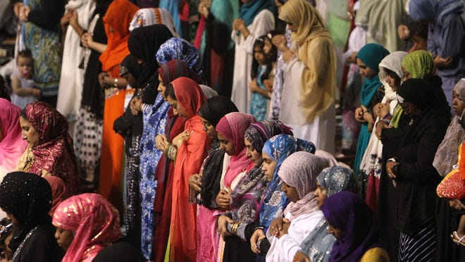File photo: An observance of the  end of Ramadan with a prayer service at the at the Henrietta Dome Arena.