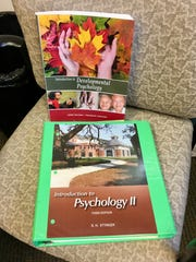 Students at South Louisiana Community College have the option to purchase a textbook version that is printed out and put into a binder, which costs hundreds of dollars less than a bound hardback textbook.