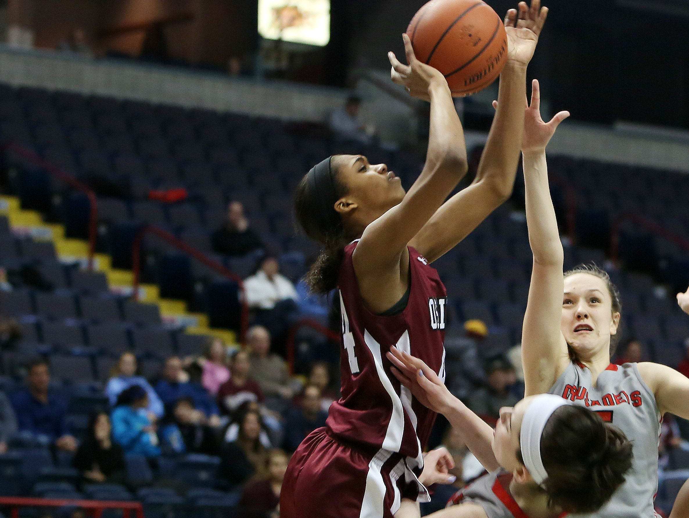 Ossining's Aubrey Griffin (44) goes up for a shot in front of Long Island Lutheran's Jenna Siletti (33) during the girls Class A final of the New York State Federation Tournament of Champions at the Times Union Center in Albany March 18, 2016.
