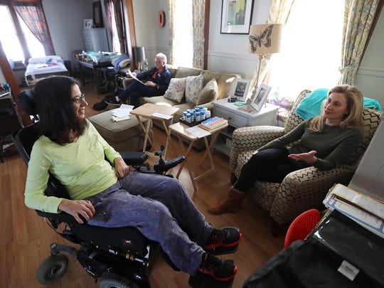 Christine Danza speaks with her friend Julia Rosenfeld at Danza's Hawthorne home Monday. Danza's father, Robert Dominici, is shown in the background.