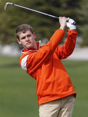 Mishicot golfer Austin Schnell takes a shot during practice Wednesday in Mishicot.