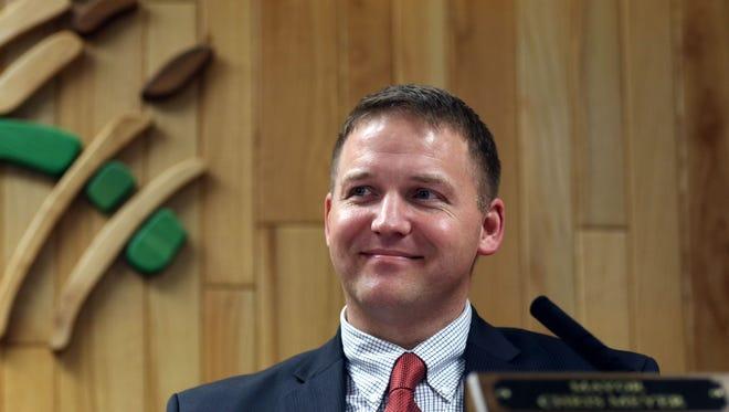 Marshfield Mayor Chris Meyer smiles during the Marshfield City Council meeting on January 26, 2016.