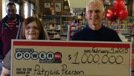 Lottery winner Patricia Pearson, of Villa Hills, stands with the store manager who notified her she had won.