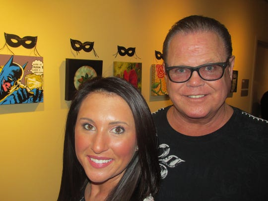 Jerry Lawler exhibited his Batman painting in Incognito. With him is Lauryn McBride.