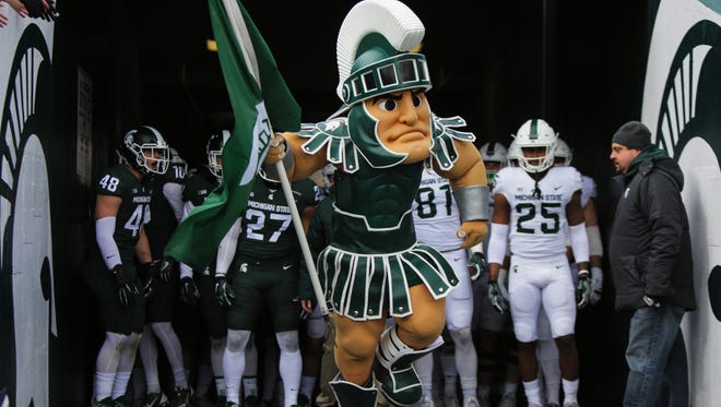 Sparty leads out the Spartans before the Green/White Spring Game at Spartan Stadium.