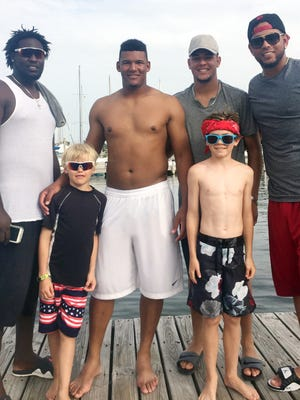 Former Blue Wahoos players, left to right Domingo Tapia, Keury Mella, Luis Castillo and Ariel Hernandez join with two of Clifton Mitchell's young boys last season following a fishing outing when the Mitchells' were a host family. The Blue Wahoos are in need of more host families for the 2018 season.   In the photo from left to right are his kids along with Blue Wahoos pitchers, Domingo Tapia, Keury Mella, Luis Castillo (now on the Reds) and Ariel Hernandez after a day on the boat.