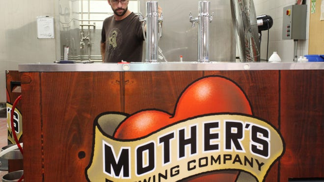 John Inmon cleans a kegerator at Mother's Brewing Company, based in central Springfield.