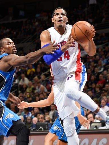 Pistons' Tobias Harris scores over the Orlando Magic's