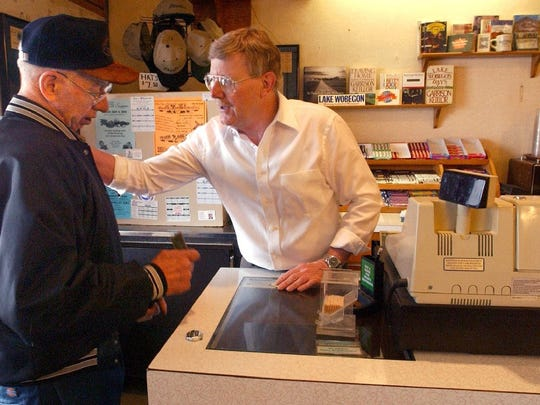 Bud Heidgerken, right, has a warm word with customer Stephen Hartung of Avon as he worked behind the register of Charlie's Cafe on the morning of  Friday, April 18, 2003. Heidgerken no longer owns the cafe that inspired Garrison Keillor's Chatterbox Cafe, but Charlie's is still in business under new ownership.