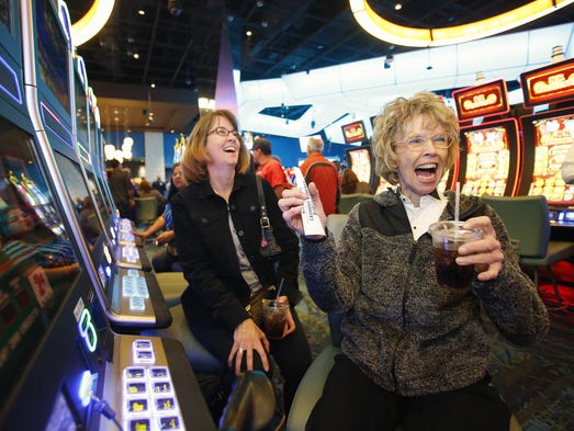 Kathy Curley, left,  celebrates their winnings with