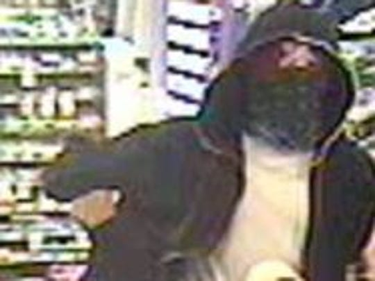 Delhi Township police are looking for this man responsible for robbing a Speedway gas station Saturday, July 5, 2014.