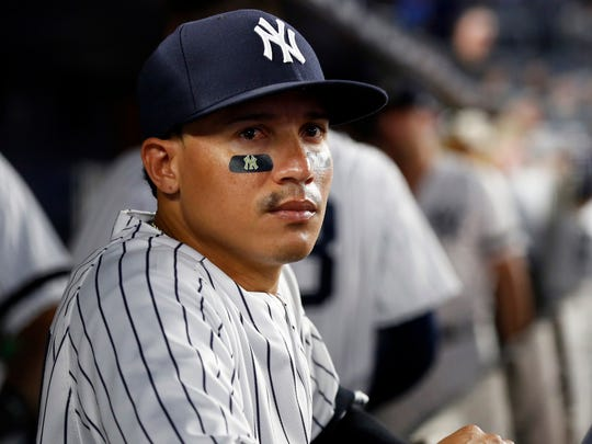 Sep 27, 2017; Bronx, NY, USA; New York Yankees second baseman Ronald Torreyes (74) looks on from the dugout against the Tampa Bay Rays at Yankee Stadium.