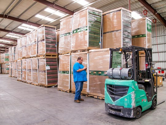 Jim Shaffer counts pallets of recycled egg cartons
