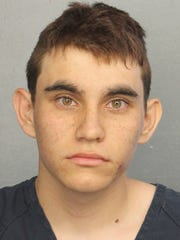 This photo provided by the Broward County Jail shows Nikolas Cruz.  Authorities say Cruz, a former student opened fire at Marjory Stoneman Douglas High School in Parkland, Fla., Wednesday,  Feb. 14, 2018, killing more than a dozen people and injuring several.
