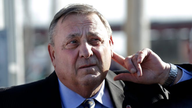 Maine Gov. Paul LePage strains to hear a question from a reporters at a campaign appearance at Becky's Diner, Wednesday, May 7, 2014, in Portland, Maine.