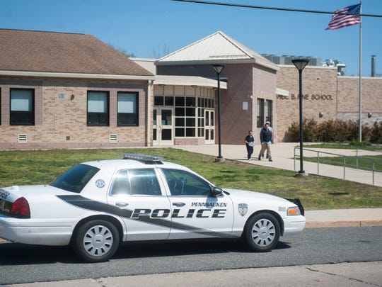 A police car sit outside of the George B. Fine Elementary School in Pennsauken after two students and two teachers were bit by a dog on the school's playground Wednesday.  04.06.16