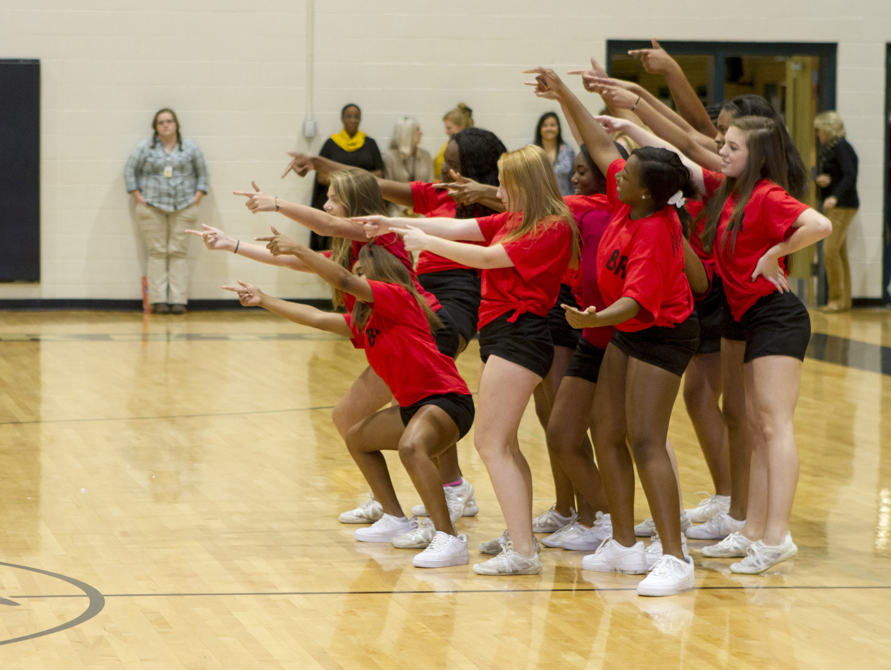 The competition in the dance-off fight back. The Greer High School cheerleaders performed a skit at its pep rally leading up to the Blue Ridge High School football game.