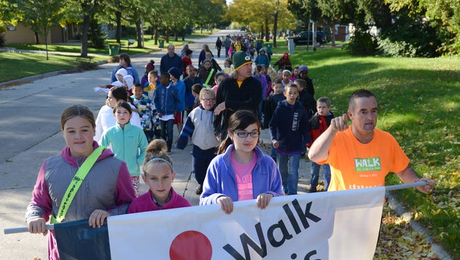 Green Bay mayor Jim Schmitt, right, joins with students, parents and staff, for the Walk to School Day event at Baird Elementary School on Oct. 8.
