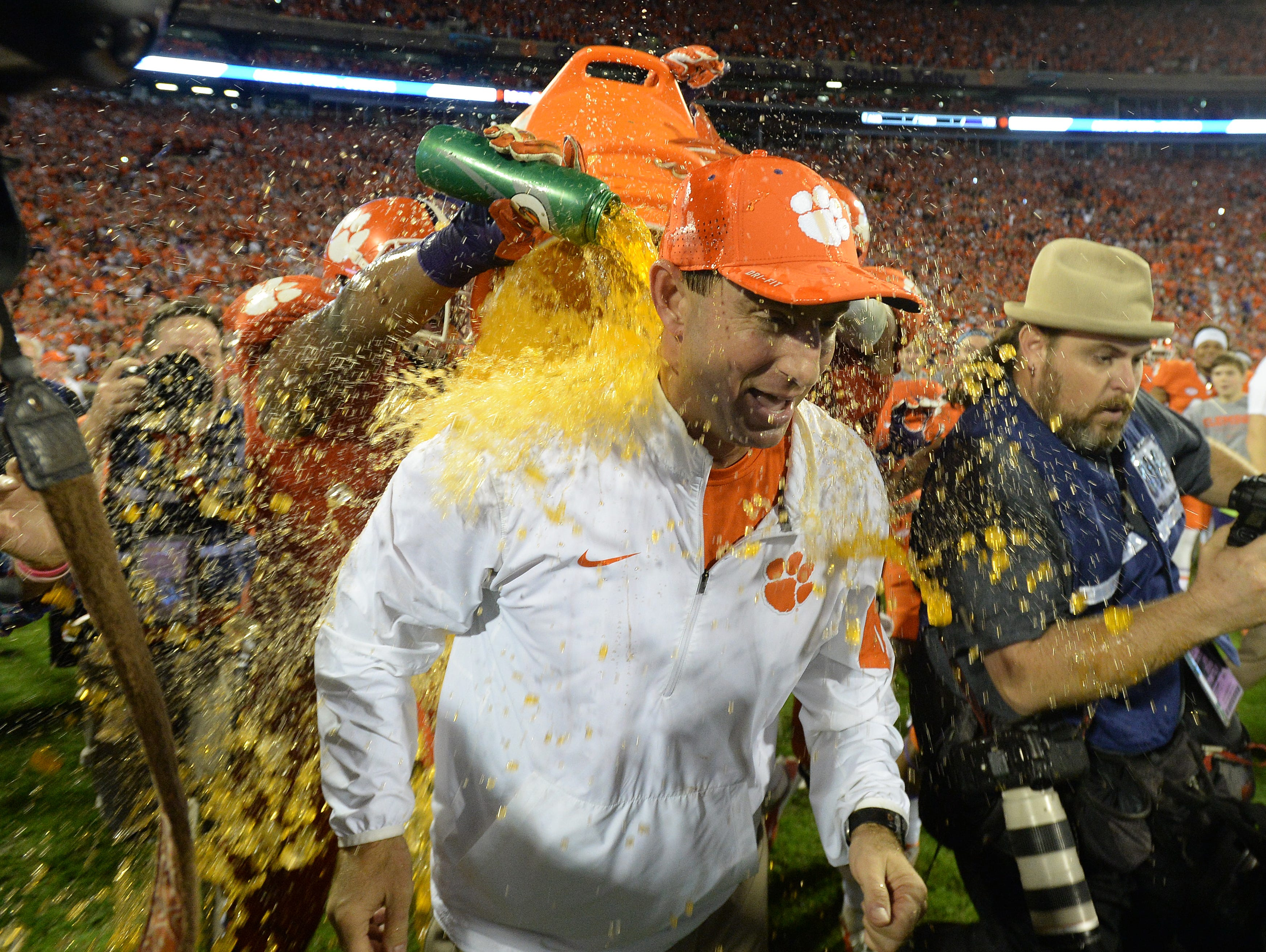 Clemson head coach Dabo Swinney is doused with Gatorade by running back C.J. Davidson (21) and running back Zac Brooks (24) after the Tigers 23-13 win over Florida State Saturday, November 7, 2015 at Clemson's Memorial Stadium.