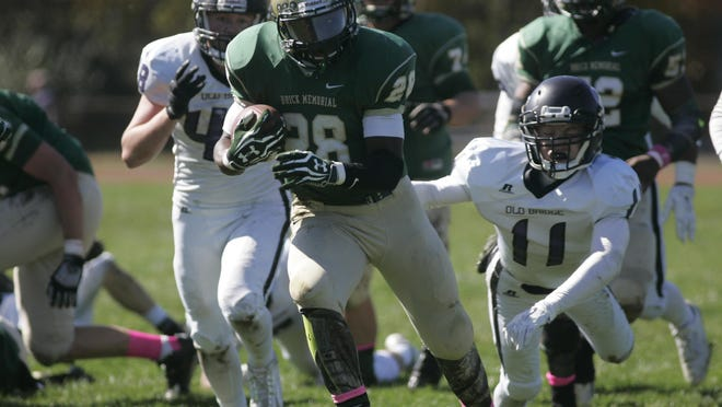 Brick Memorial High School running back Tony Thorpe runs away from the Old Bridge High School defense in a non conference game against, Saturday afternoon, Oct. 10, 2015, in Brick.