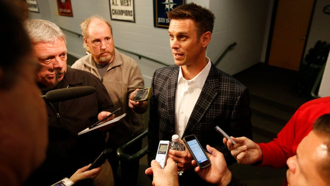 Seattle Mariners general manager Jerry Dipoto answers questions during a baseball press conference Thursday, Dec. 3, 2015, in Seattle, where the team introduced their newest outfielder Nori Aoki.