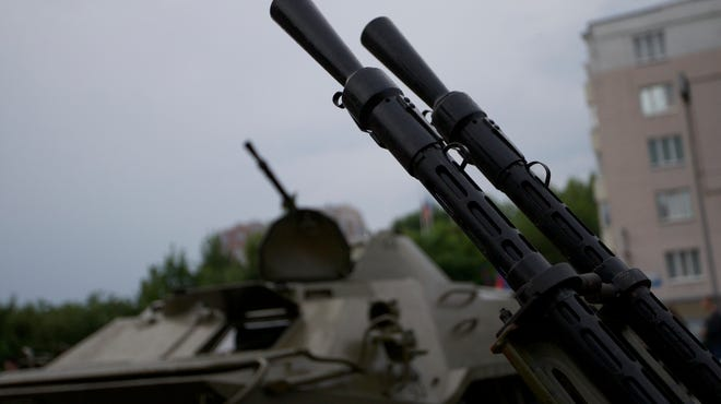 Barrels of an anti-aircraft gun and an APC are seen outside the administration building in Donetsk, Ukraine, on May 29, 2014.