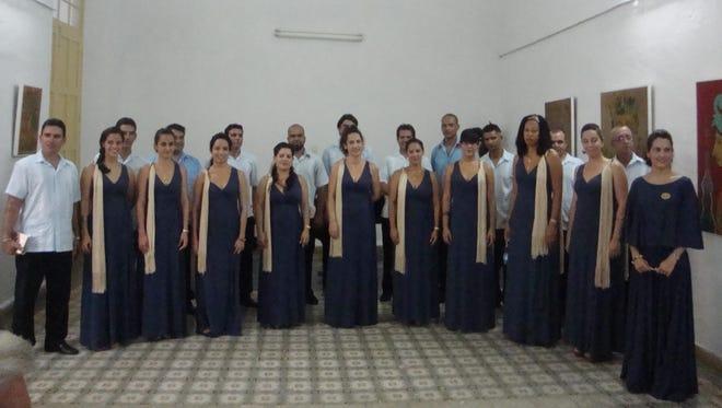 The Cantores de Cienfuegos choir pose after a performance in Cienfuegos, Cuba in late 2013.