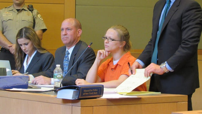 Angelika Graswald, second from the right, listens in Orange County Court on Tuesday, with lawyer Richard Portale on the right, and from left associate Kimberly Pelesz and co-counsel Jeffrey Chartier.