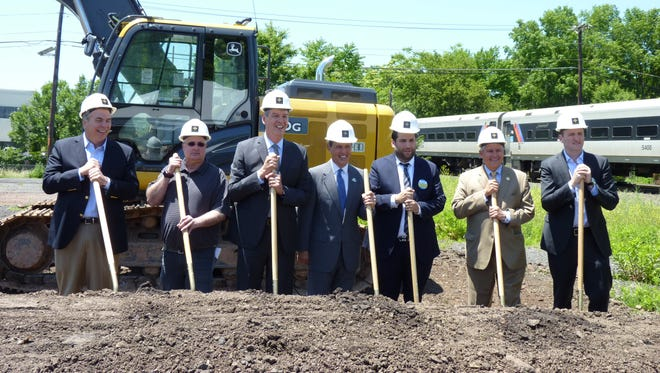 Local, county and state officials met with the developer of a new apartment in Raritan Borough for the complex's groundbreaking on June 12, 2018.