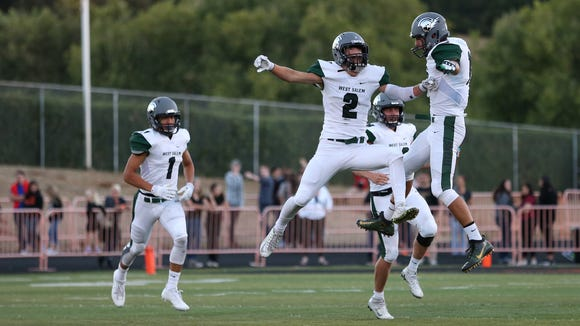 West Salem players celebrate a touchdown against Sprague during a Greater Valley Conference game on Friday, Sept. 9, 2016, at Sprague High School. West Salem defeated Sprague 36-29.