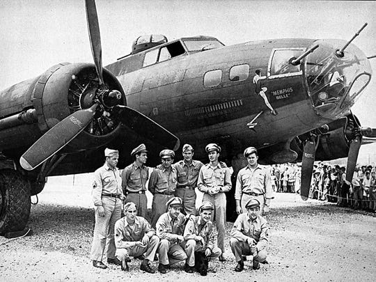 FILE - This 1943 file photo shows the crew of the Memphis Belle, a Flying Fortress B-17F, poses in front of their plane in Asheville, N.C.  Standing from left to right:  tail gunner John P. Quinlan of Yonkers, N.Y.; nose gunner Charles B. Leighton of East Lansing, Mich.; co-pilot James Verinis of New Haven, Conn.; pilot Robert K. Morgan of Asheville, N.C.; bombardier Vincent Evans of Buellton, Calif.; radio operator Robert J. Hansen of Billings, Montana.  Kneeling from left to right: waist gunner C.A. Nastal of Arlington Heights, Ill.; ball turret gunner Cecil H. Scott of Iselin, N.Y.; waist gunner C.E. Winchell of Barrington, Ill.; and navigator Harold P. Lock of Green Bay, Wisconsin. The most celebrated American aircraft to emerge from the great war rests these days in a cavernous hangar at a southern Ohio Air Force base undergoing a loving and fastidious restoration _ from its clear plastic nose cone down to the twin .50-caliber machine guns bristling in the tail. (AP Photo, file)