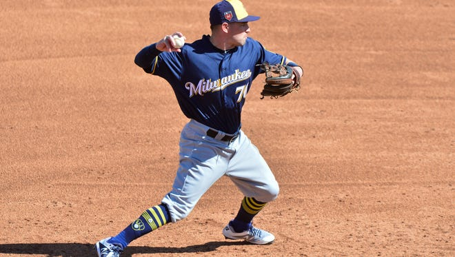 Brewers third baseman Nate Orf  throws to first base during a spring training game.