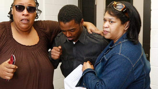 An emotional Joshua Blunt, center, is surrounded by family members after being released from the Grenada County Jail in Grenada May 24. He has now been indicted.