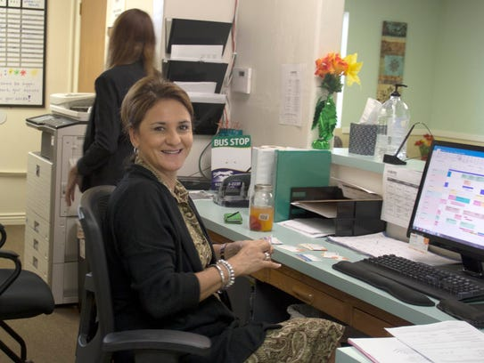 Sylvia Flores, pictured in her office, is the site