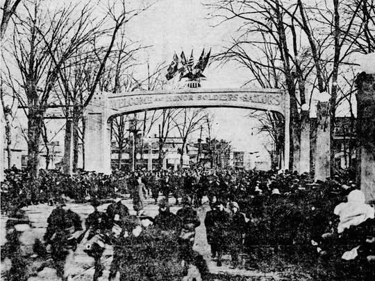 The parade under the Victory Arch in Wisner Park on