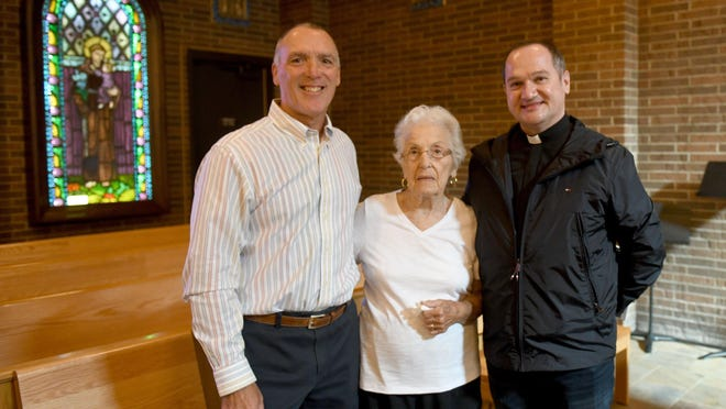 Little Flower Catholic Church in Plain Township has installed two 1929 stained-glass windows donated by the DiGirolamo family. The windows were part of the original Little Flower church in Middlebranch. Pictured are (left to right) Anthony DiGirolamo Jr., his mother, Flo, and the Very Rev. Canon Christopher Henyk. Monday, August 31,  2020.