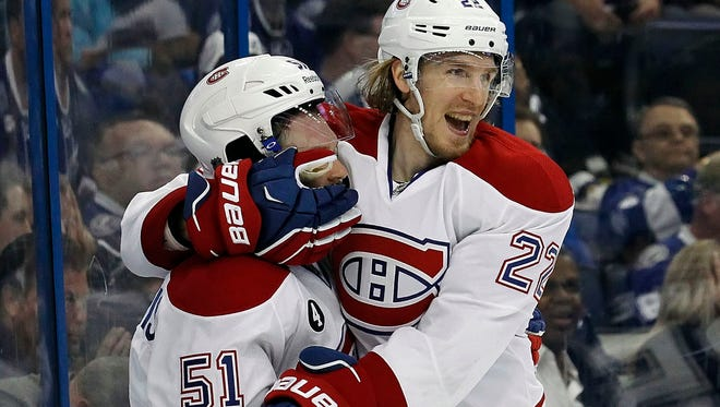 Montreal Canadiens center David Desharnais (51) is congratulated by right wing Dale Weise (22) after he scored a goal against the Tampa Bay Lightning.
