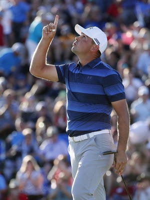 Gary Woodland points after winning the Waste Management Phoenix Open on the first playoff hole in Scottsdale, Ariz. February 4, 2018.