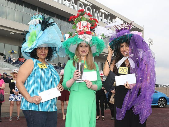 $1,000 derby hat contest runners up with the winner.