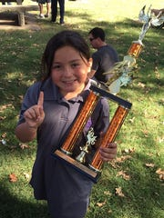 Allison Menchaca, first place winner in the seven- year-old division at the tournament.